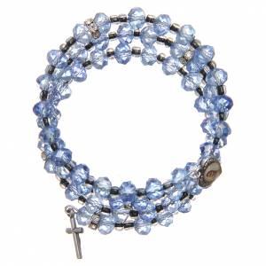 Bracelets, dizainiers: Bracelet à ressort perles bleu clair croix Notre-Dame Medjugorje