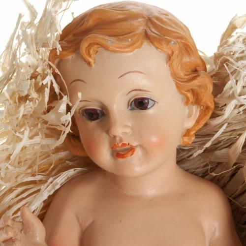 Enfant Jésus polyrésine avec paille différe s2