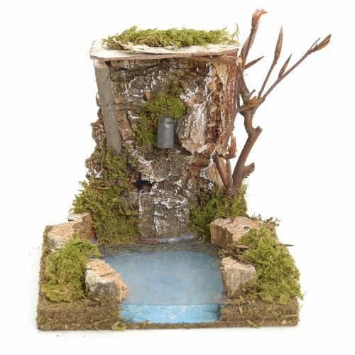 Fontaine avec rochers milieu pour crèche s1