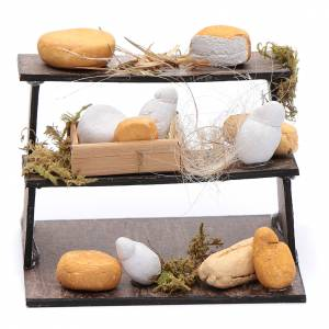 Neapolitan Nativity Scene: Forms of cheese on three-floor Neapolitan nativity scene stand