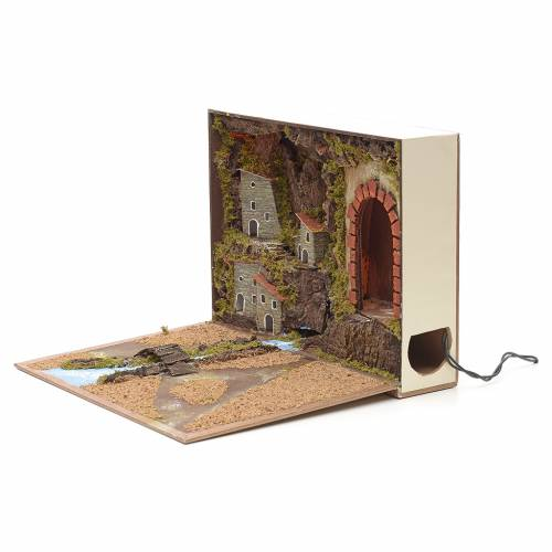 Illuminated village with river for nativities inside a book 24x3 s2
