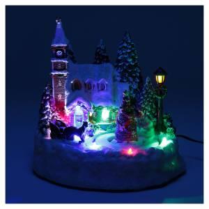 Paisaje de Navidad iluminado con niños en movimiento 20x20x15 cm s4