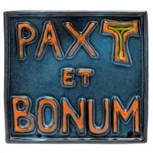Various bas reliefs: Pax et Bonum ceramic basrelief