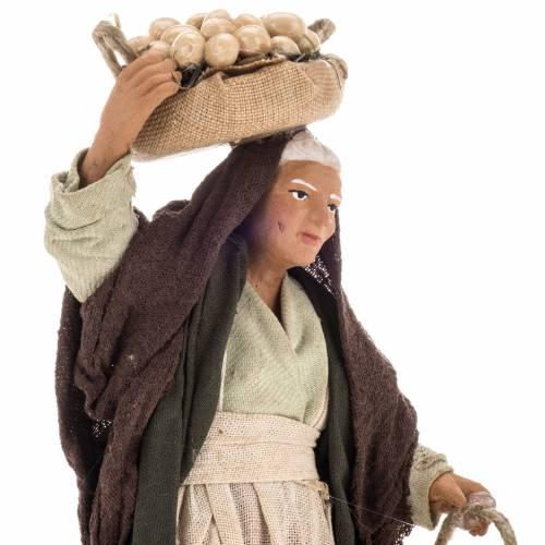 Pesebre mujer anciana con cestas de huevos 14 cm s2