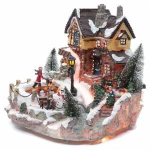 Pueblos navideños en miniatura: Pueblo Navideño en miniatura pista de patinaje sobre hielo movimiento y luces 25x30x30 cm