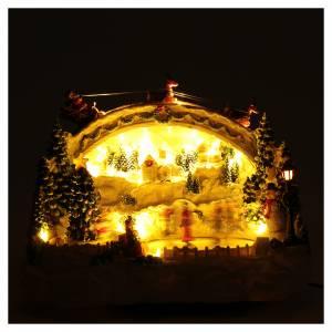 Villaggio natalizio bianco luminoso musica movim pattinatori albero natale 24X33X21 cm s4
