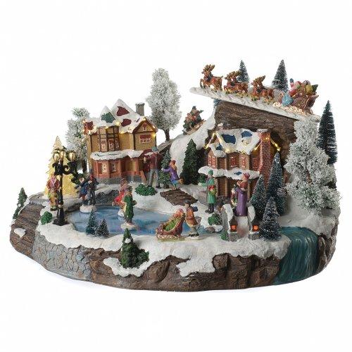 Villaggio natalizio lago pattinatori e slitta in movimento illuminato e musicale 55x40x30 s2