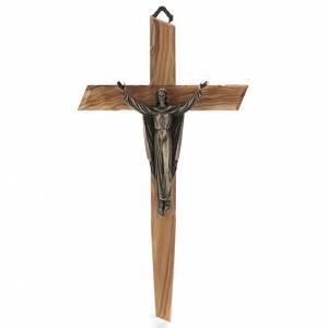 Kruzifixe aus Holz: Auferstandene bronzefarbige Christus auf Olivenholz Kreuz.