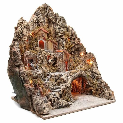 Bourgade illuminée avec grotte et fontaine crèche 68x64x56 cm s3