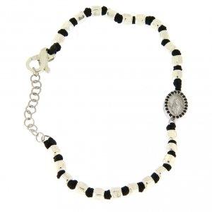 Silver bracelets: Bracelet with silver beads sized 2 mm on a black cotton cord and a black zirconate Saint Rita medalet