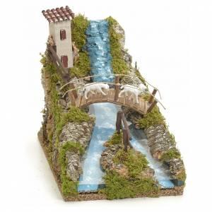 Corriente de río con puente y ovejas: ambiente pesebre s1