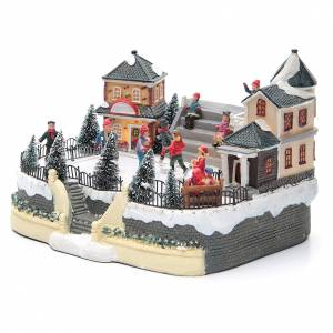 Christmas villages sets: ice skaters for Christmas village 20x20x20 cm with lights and music