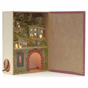 Illuminated village with grotto for nativities inside a book 24x s1