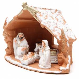 Nativity decorated terracotta with hut and snow h. 20x14x18cm s2