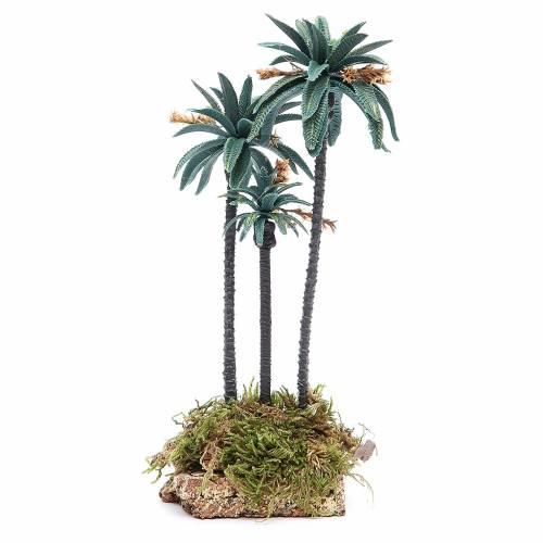 Palmier triple avec fleurs h 23 cm en pvc s1