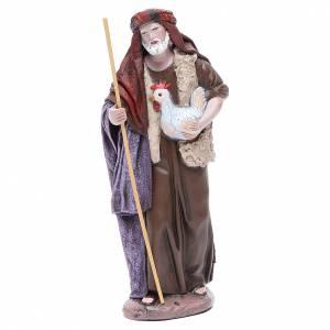 Pastor con gallina belén terracota 17 cm s1