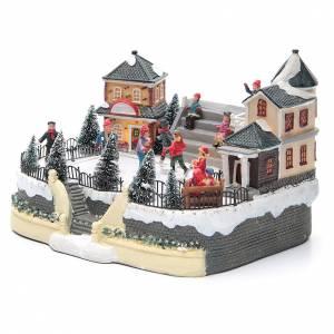 Villages de Noël miniatures: Patineurs village hivernal 20x20x20 cm éclairage musique
