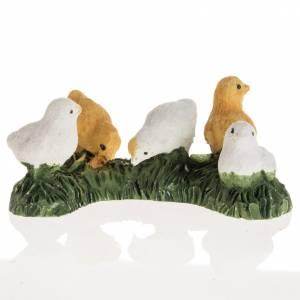 Animales para el pesebre: Pollitos belén resina 14 cm.