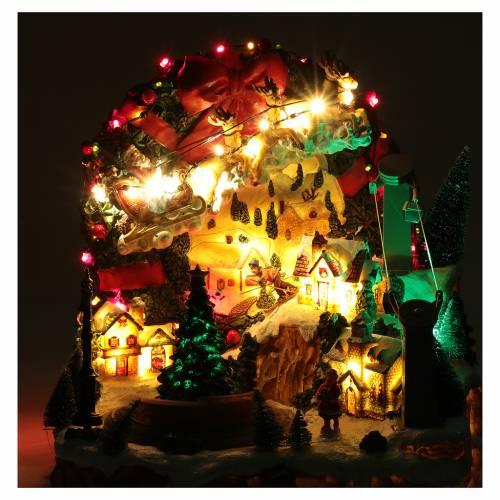 Scena natalizia con luci e treno in movimento 30x30x25 cm s4
