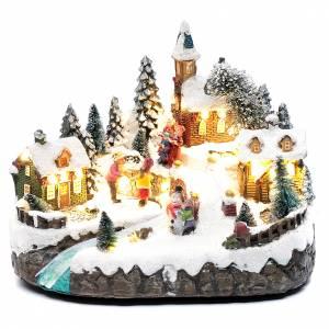 Villages de Noël miniatures: Village animé avec patinage et ruisseau 20x25x20 cm