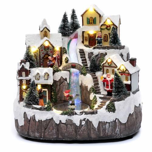 Villaggio di Natale con ruscello di fibra e musica 25x25x17 cm s1