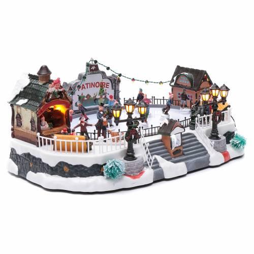 Villaggio natalizio animato luminoso musicale movimento pattinatori 18X40X27 cm s3