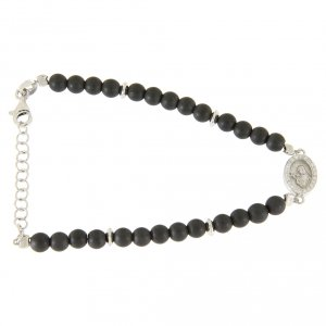 Silver bracelets: Bracelet with opaque hematite balls, details and Saint Rita medalet with white zircons