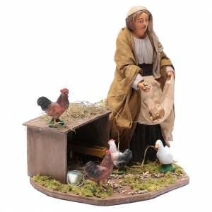 Presepe Napoletano: Donna che nutre galline movimento 30 cm presepe napoletano