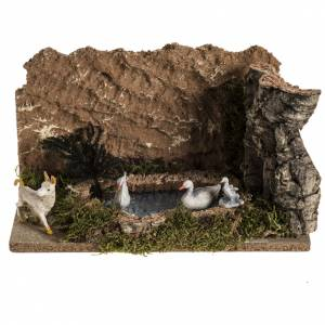 Nativity scene figurines, ducks in the lake and goat s1