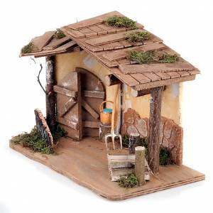 Stables and grottos: Nativity stable with plaster wall and tools