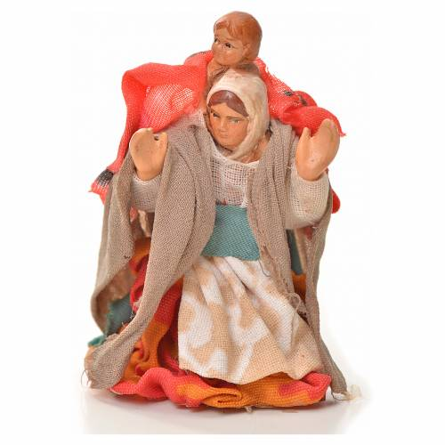 Neapolitan Nativity figurine, woman carrying child on shoulders s1