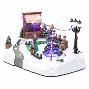 Pueblos navideños en miniatura: Paisaje de Navidad con negocio navideño música y árbol en movimiento 20x25x20 cm