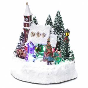 Pueblos navideños en miniatura: Paisaje de Navidad iluminado con niños en movimiento 20x20x15 cm