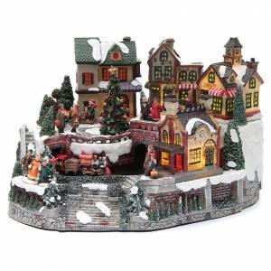 Pueblos navideños en miniatura: Pueblo Navideño estación y tren resina 35x25x20 cm