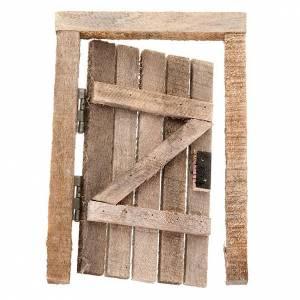 Barandillas, puertas, balcones: Puerta de madera con jambas y bisagra para el belén