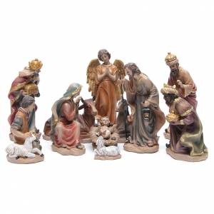 Resin and Fabric nativity scene sets: Resin nativity set measuring 20.5cm, 11 figurines with golden finish