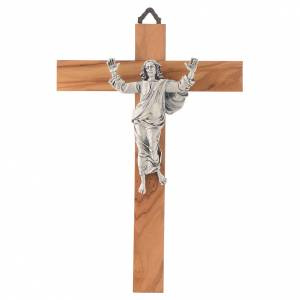 Wooden crucifixes: Resurrected Christ in silver-plated metal on olive wood