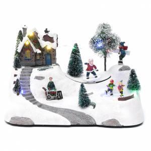 Villages de Noël miniatures: Scène Noël musique et piste en mouvement 20x30x15 cm