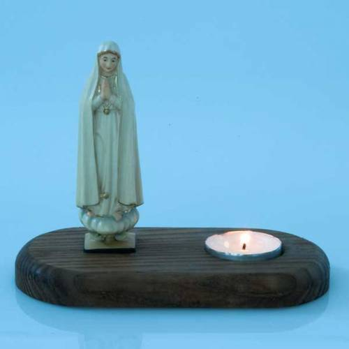 The Virgin of Fatima with votive candle s3