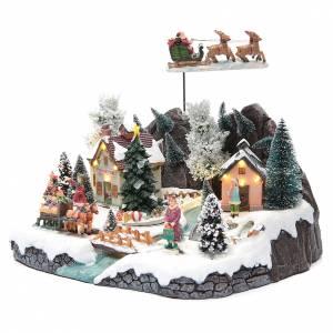 Villages de Noël miniatures: Village hivernal traîneau Père Noël 30x25x25 cm