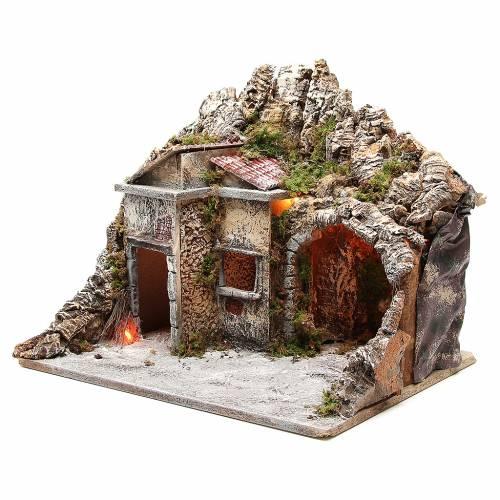 Cabane avec maisons et effet feu 50x43x40 cm s2