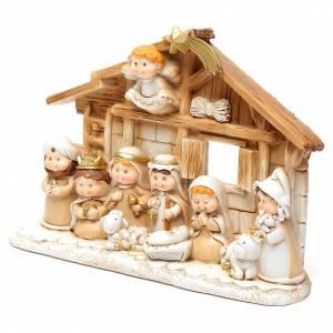 Resin and Fabric nativity scene sets: Children resin nativity scene hut15x20 cm