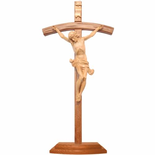 Curved crucifix with base, patinated Valgardena wood s1