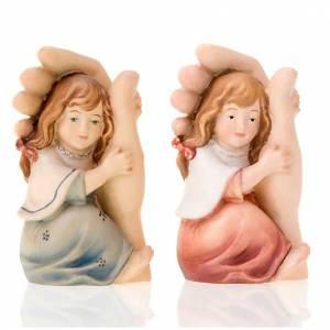 Statuen aus gemalten Holz: Hand Gottes und Maedchen