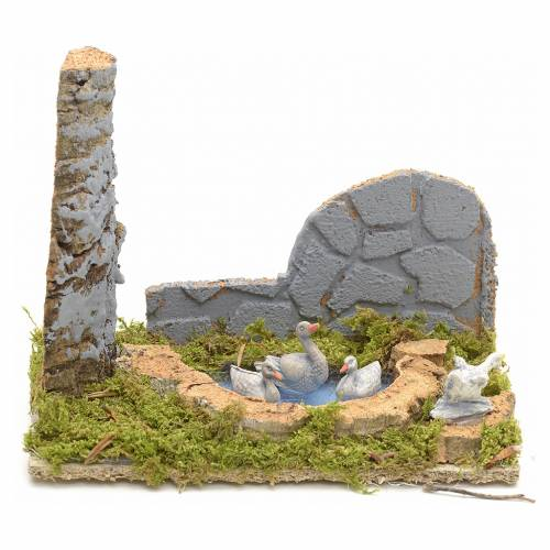 Nativity scene figurines, geese in the fake pond s1