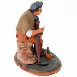 Nativity set accessory, Farmer at rest clay figurine s3