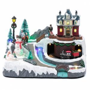 Pueblos navideños en miniatura: Paisaje de Navidad con musica tren y muñeco de nieve en movimiento 20x25x20 cm