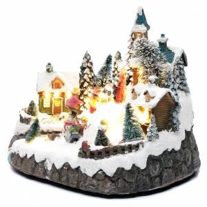 Pueblos navideños en miniatura: Paisaje navideño animado con patinadores y arroyo 20x25x20 cm