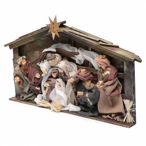 Resin and Fabric nativity scene sets: Resin nativity scene setting in hut with frame 35 cm