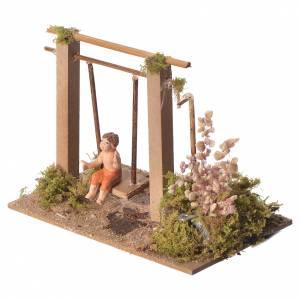 Scène animé enfant sur balançoire 10 cm s2